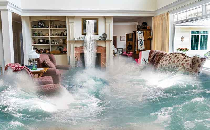 Photo of a lounge room getting completely flooded and an emergency plumber Melbourne