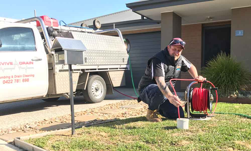 Photo of our director and emergency plumber Melbourne performing our blocked drains & drain relining services